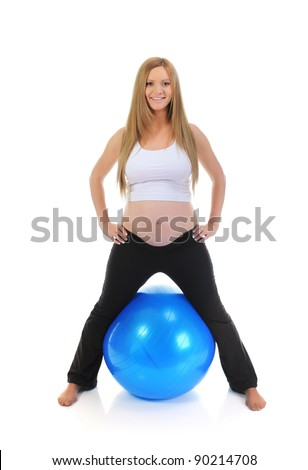 Beautiful pregnant woman sitting with exercise bal. Isolated on white background - stock photo