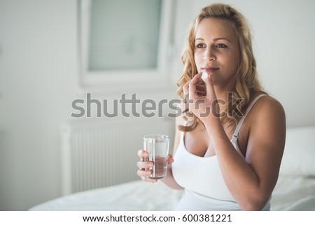 Pregnant Woman Taking Pill Against Heartburn Stock Photo ...
