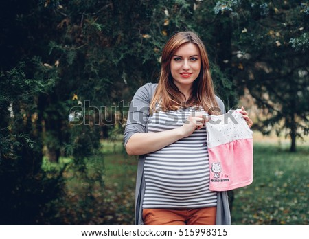 Beautiful pregnant woman with a big belly and dress