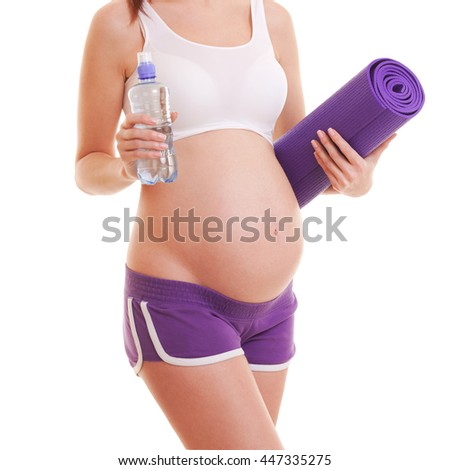 Beautiful pregnant woman with exercising mat and water on white background - stock photo