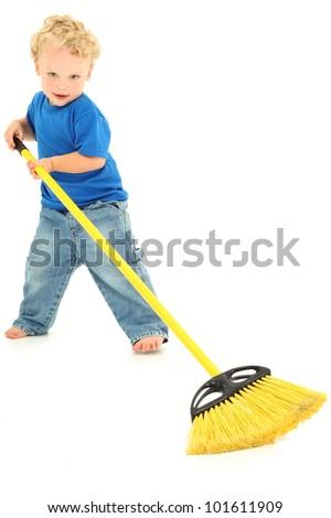 Beautiful Preschool Toddler Boy Sweeping Floor Over White - stock photo