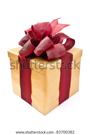 Beautiful present box with overwhelming bow isolated on white - stock photo