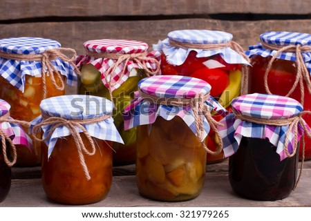 Beautiful preserving of fruits and vegetables in the cellar. - stock photo