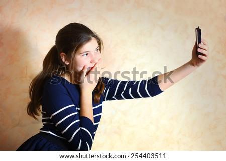 beautiful preteen girl make selfi - stock photo