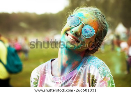 beautiful preteen girl portrait participating  in indian color holi fest  - stock photo