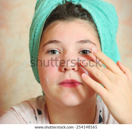 beautiful preteen girl with wet hair in towel after shower - stock photo