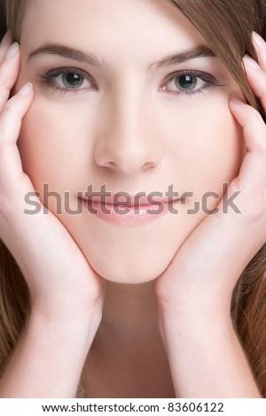 Beautiful pretty girl face closeup - stock photo