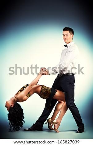 Beautiful professional artists dancing passionate dance.  - stock photo