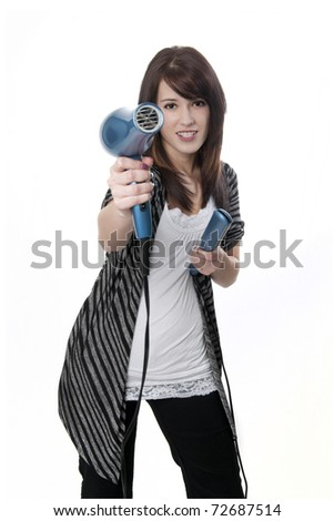 Beautiful professional hair stylist holding blow dryer and straghtener - stock photo