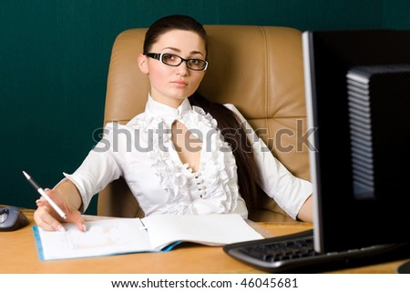 Beautiful professional woman working in office - stock photo