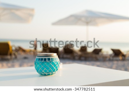 Beautiful promenade. Gorgeous sea beach. Beach umbrellas Sea - stock photo