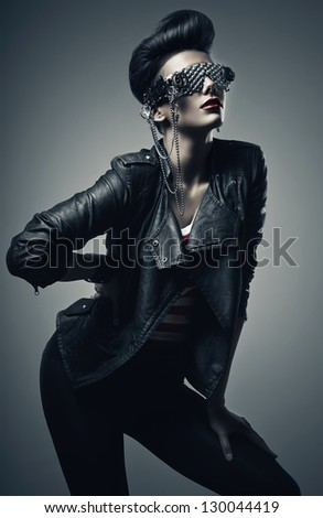 beautiful punk woman in black leather jacket - stock photo