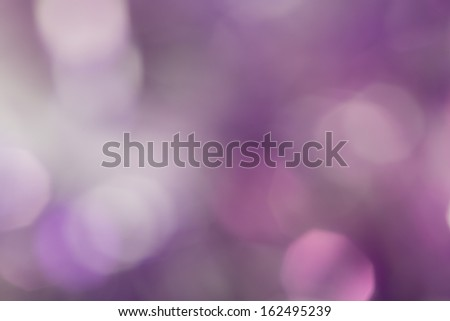 Beautiful purple bokeh as background - stock photo