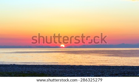 Beautiful purple sea sunset - stock photo