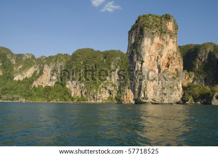 Beautiful Railay Beach is one of the most stunning locations in southern Thailand. Formed by a deer's neck of sand that connects the mainland to a spectacular cluster of limestone outcrops. - stock photo