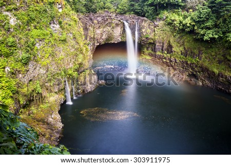 Beautiful Rainbow Falls in Hilo Hawaii forms cascading flows into a natural pool and often casts colorful rainbows when the sun position is just right, as shown here.