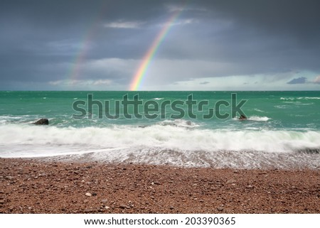 beautiful rainbow over ocean coast, Normandy, France - stock photo