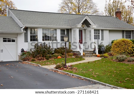 Beautiful Ranch home Bay Window Red Door Autumn Overcast Day Residential neighborhood USA - stock photo