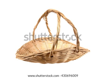 Beautiful rattan basket with handle isolated on white background - stock photo