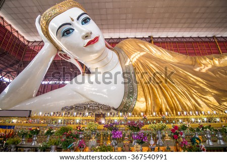 Beautiful reclining buddha image Chauk htat gyi reclining buddha (sweet eye buddha), yangon, myan - stock photo