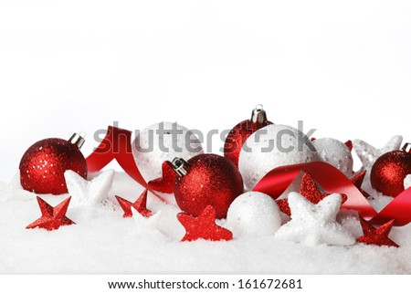 Beautiful red and white Christmas decoration with snow - stock photo