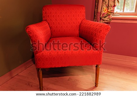 beautiful red armchair on the living room in Quebec country, Canada