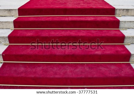 beautiful red carpet leading up old steps - stock photo