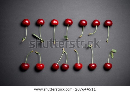 Beautiful red cherries on black background.