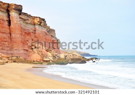 Beautiful Red Cliffs Edging the Tropical Coastline of Angola, Southern Africa - stock photo