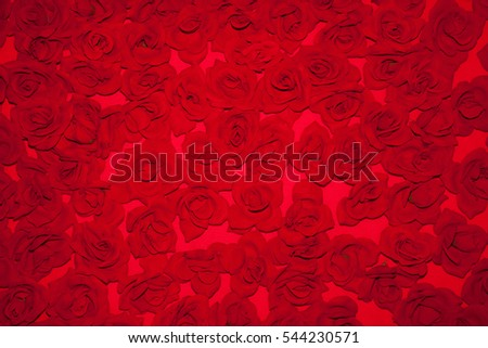 Beautiful Red Floral background. Art Pattern of bright red artificial flowers roses on white background. Can be used for the decoration of Valentine's Day. Horizontal Image
