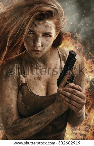 Beautiful red hair army girl holding pistol - stock photo