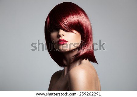 Beautiful red hair model with perfect glossy hair. Close-up portrait. - stock photo