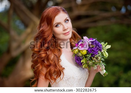 Beautiful red-haired bride. Wedding hairstyle - stock photo