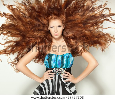 Beautiful red-haired fashion model posing - stock photo