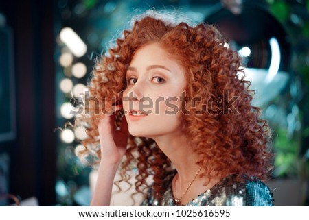 beautiful red-haired girl, Afro curls on green background