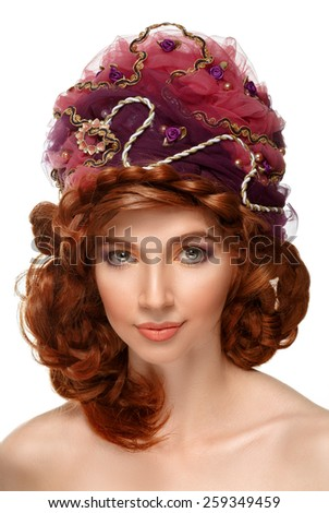 Beautiful red-haired girl in a headdress on white background. Hair braided. Looking at the camera. Isolated. - stock photo