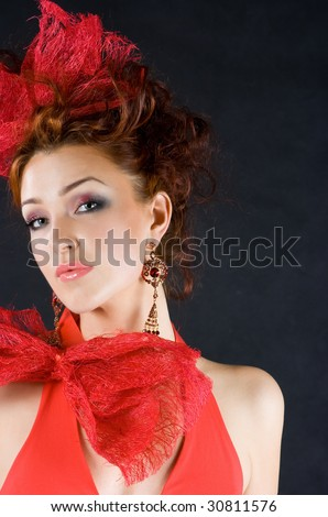 Beautiful red-haired girl in old fashion style studio shot