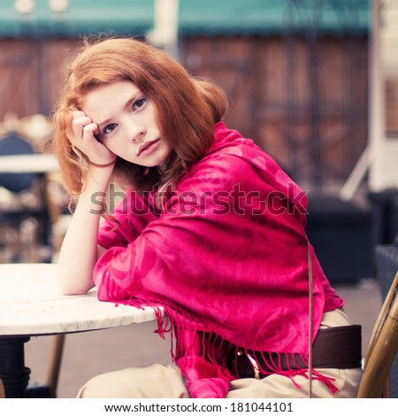 beautiful red-haired girl in the morning in a cafe - stock photo