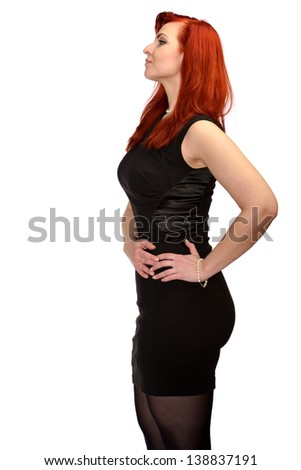 Beautiful red-haired girl posing in a studio. Isolated on white background.  - stock photo