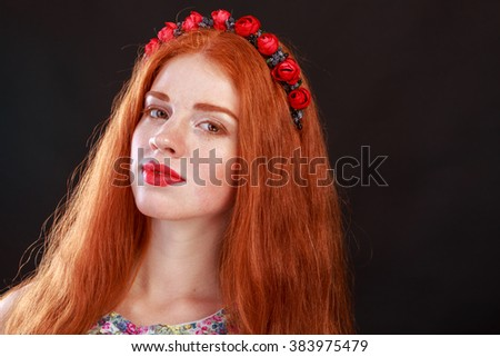 Beautiful red-haired girl with a wreath in her hair. Accessories for hair - wreaths. Hair ornaments. Gorgeous red-haired girl. - stock photo