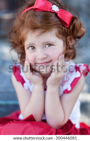beautiful red-haired girl with beautiful eyes in platitse - stock photo