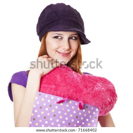 Beautiful red-haired girl with heart in bag. Studio shot. - stock photo