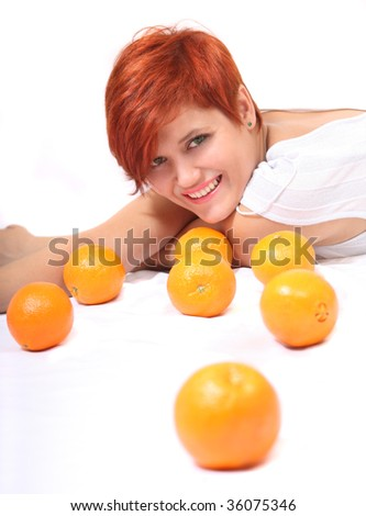Beautiful red-haired girl with juicy orange
