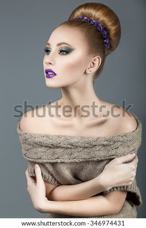 Beautiful red-haired girl with purple lips, smooth hair and an ornament in the head. Beauty face.  - stock photo