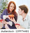beautiful red haired pregnant pregnant woman and pancake - stock photo