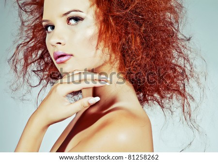 Beautiful red-haired woman - stock photo
