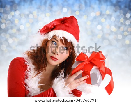 beautiful red head girl in christmas costume isolated on white