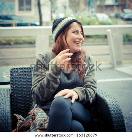 beautiful red head woman in the city