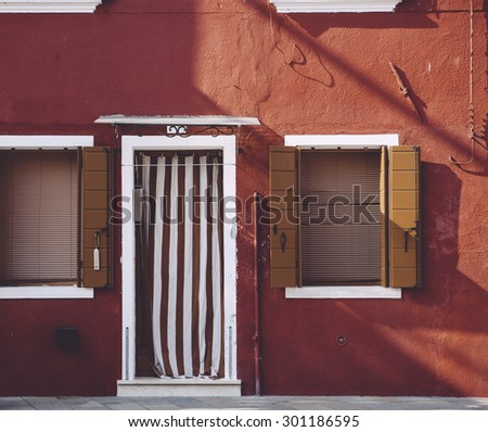 Beautiful red house wall on Burano island in Veneto, north Italy