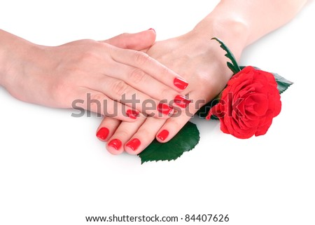 beautiful red manicure and  flower onwhite background